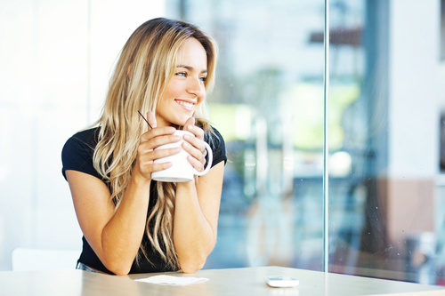 lady relaxing in clean home with cup of coffee