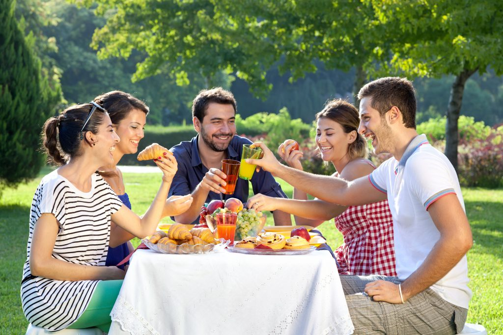 group of friends having a picnic outside