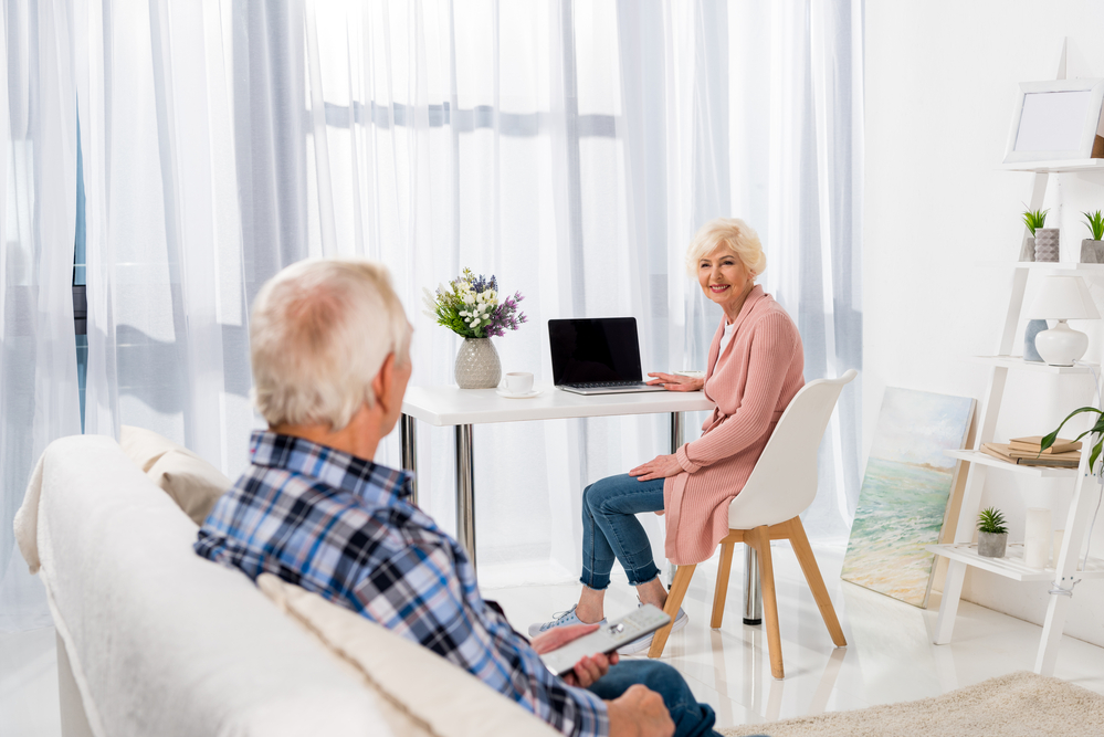 retired couple in clean unit with laptop