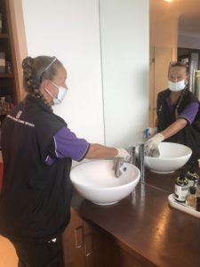 Australian Customised Cleaning Services employee cleaning with mask and gloves during the CoVid19 pandemic
